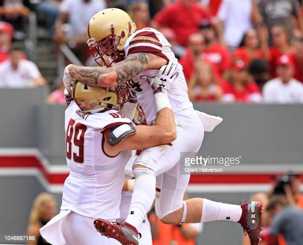 Ben Glines celebrates with teammate Tommy Sweeney of the Boston College Eagles after scoring a touchdown against the North Carolina State Wolfpack...