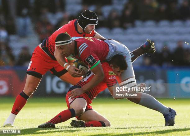 Ben Glynn of Harlequins tackled by Will Butler of Worcester Warriors and Kurt Haupt of Worcester Warriors during the AngloWelsh Cup match between...