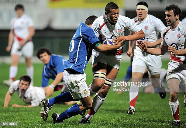 Ben Glynn runs holds off the Italian defense during the match between Italy U18 and England U18 on April 12 2009 in Viadana Italy
