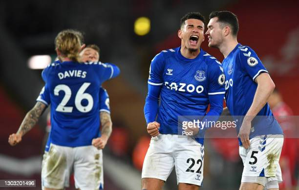 Ben Godfrey and Michael Keane of Everton celebrate following their team's victory in the Premier League match between Liverpool and Everton at...
