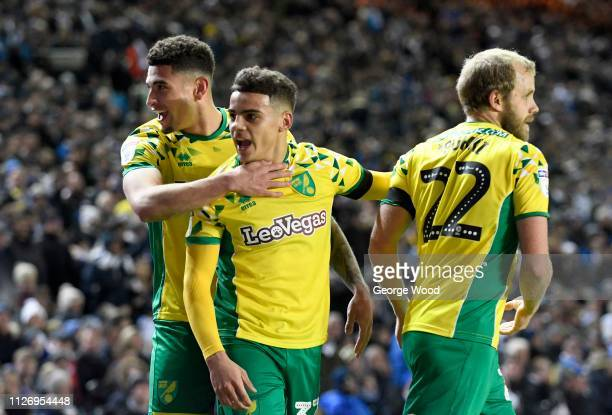 Ben Godfrey Max Aarons and Teemu Pukki of Norwich City celebrate their second goal scored by Pukki during the Sky Bet Championship match between...