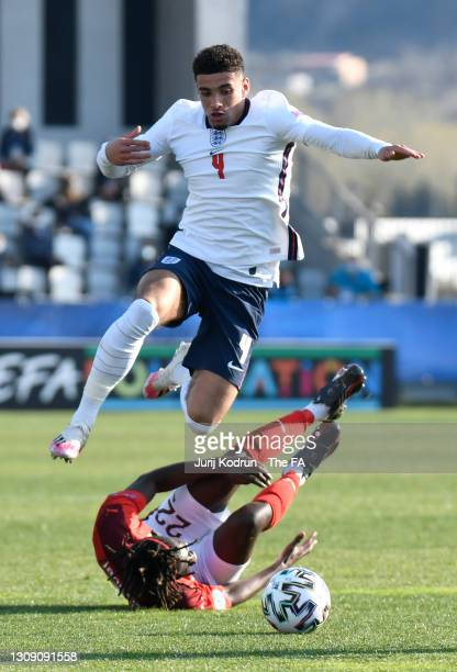Ben Godfrey of England avoids a challenge from Alexandre Jankewitz of Switzerland during the 2021 UEFA European Under-21 Championship Group D match...