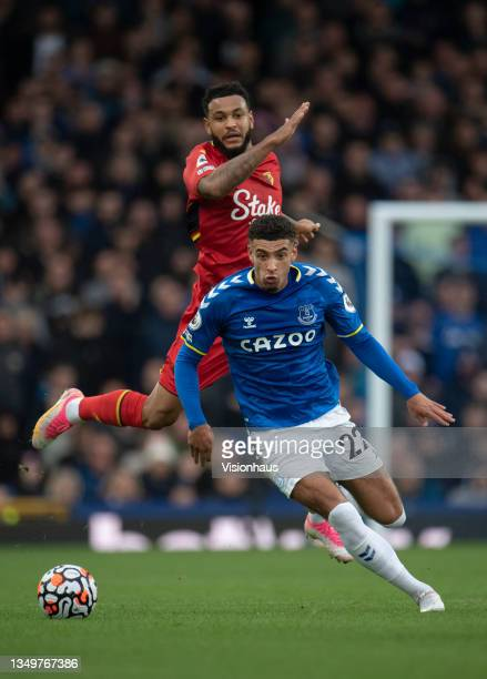 Ben Godfrey of Everton and Joshua King of Watford in action during the Premier League match between Everton and Watford at Goodison Park on October...