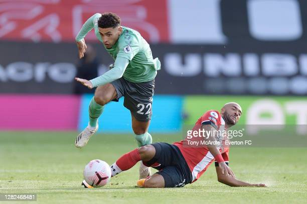 Ben Godfrey of Everton and Nathan Redmond challenge for the ball during the Premier League match between Southampton and Everton at St Mary's Stadium...