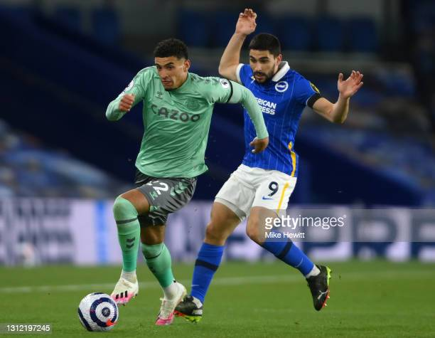Ben Godfrey of Everton gets awa`y from Neal Maupay of Brighton & Hove Albion during the Premier League match between Brighton & Hove Albion and...