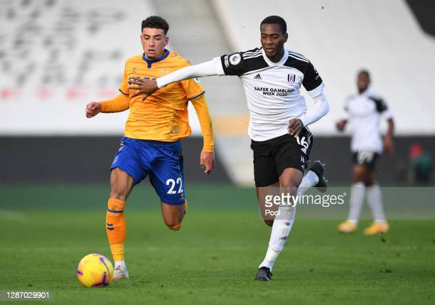 Ben Godfrey of Everton is tackled by Tosin Adarabioyo of Fulham during the Premier League match between Fulham and Everton at Craven Cottage on...