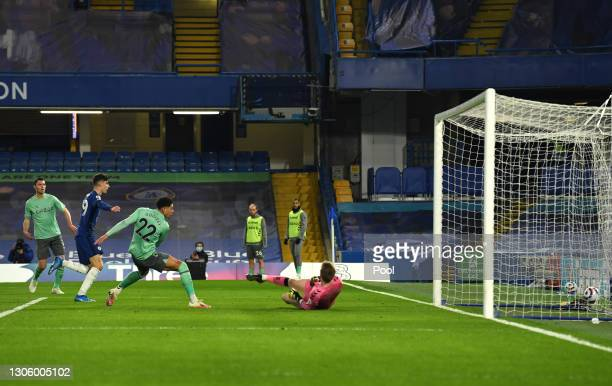 Ben Godfrey of Everton scores an own goal and chduring the Premier League match between Chelsea and Everton at Stamford Bridge on March 08, 2021 in...