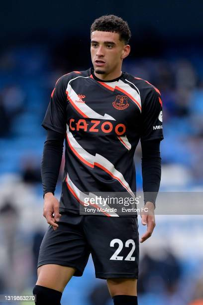 Ben Godfrey of Everton warms up before the Premier League match between Manchester City and Everton at the Etihad Stadium on May 23, 2021 in...