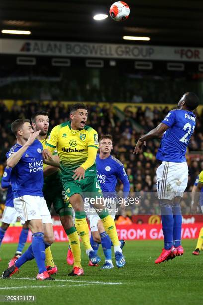 Ben Godfrey of Norwich City and Jonny Evans of Leicester City compete for the ball during the Premier League match between Norwich City and Leicester...