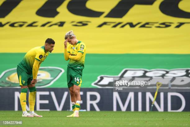Ben Godfrey of Norwich City and Todd Cantwell of Norwich City looks dejected following their sides defeat in the Premier League match between Norwich...