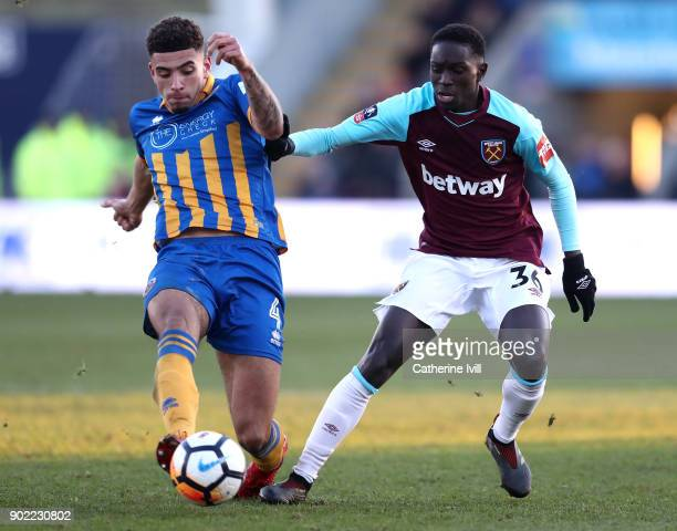 Ben Godfrey of Shrewsbury Town and Domingos Quina of West Ham United battle for the ball during The Emirates FA Cup Third Round match between...