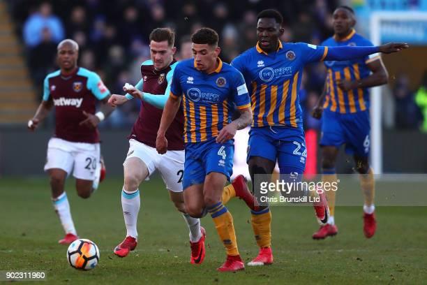 Ben Godfrey of Shrewsbury Town in action with Antonio Martinez of West Ham United during The Emirates FA Cup Third Round match between Shrewsbury...