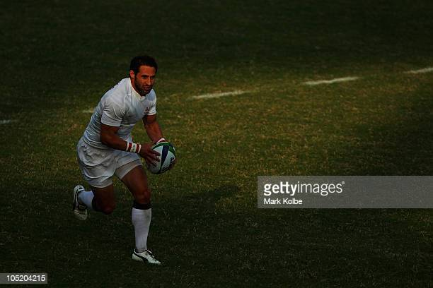 Ben Gollings of England makes a break during the rugby 7's Bronze Medal match between England and South Africa at Delhi University during day nine of...