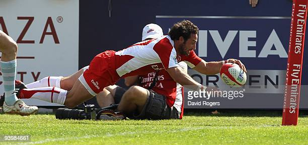 Ben Gollings of England scores the extra time match winning try against Argentina during the IRB Sevens tournament at the Dubai Sevens Stadium on...