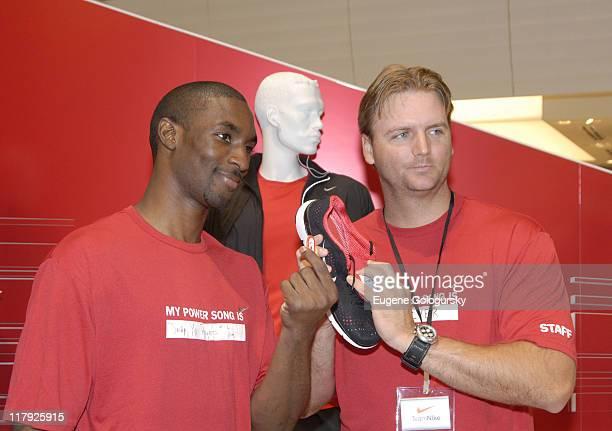 Ben Gordon AJ Pierzinski during Star Athletes Converge on Niketown for Retail Debut of Nike iPod Sports Kit July 13 2006 at Niketown in New York City...