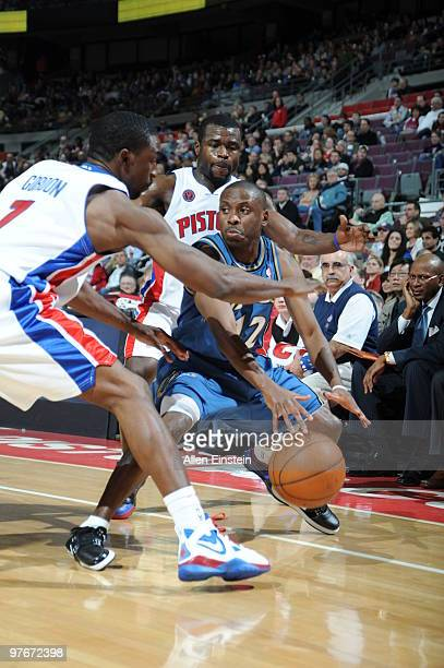 Ben Gordon and Will Bynum of the Detroit Pistons double team Earl Boykins of the Washington Wizards in a game at the Palace of Auburn Hills on March...