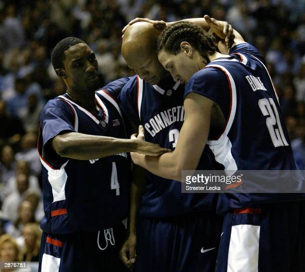 Ben Gordon, Charlie Villanueva and Josh Boone of the University of Connecticut Huskies react to a foul during their game against the University of...