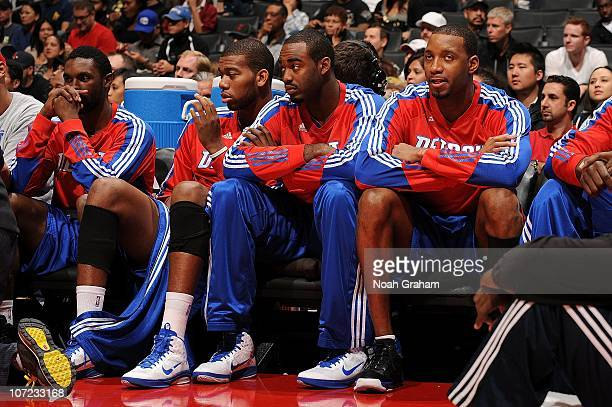 Ben Gordon Greg Monroe DaJuan Summers and Tracy McGrady of the Detroit Pistons look on from the bench during a game against the Los Angeles Clippers...