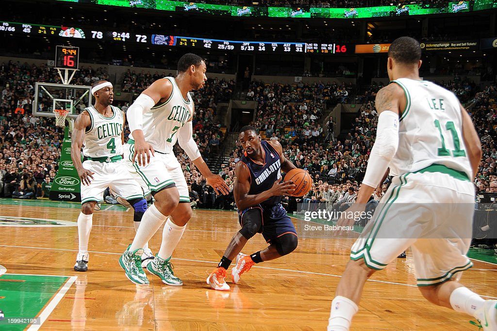 Ben Gordon #8 of the Charlotte Bobcats drives against Jason Terry #4 and Jared Sullinger #7 of the Boston Celtics on January 14, 2013 at the TD Garden in Boston, Massachusetts.