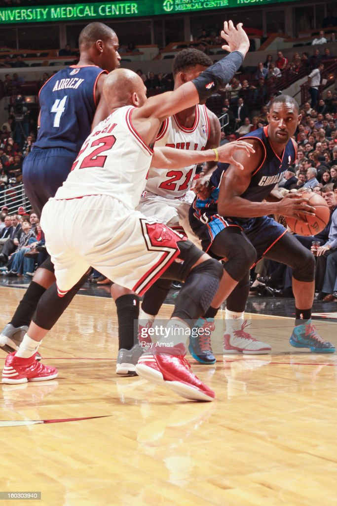 Ben Gordon #8 of the Charlotte Bobcats looks to pass the ball while guarded by Taj Gibson #22 and Jimmy Butler #21 of the Chicago Bulls on January 28, 2013 at the United Center in Chicago, Illinois.