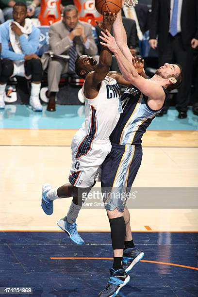 Ben Gordon of the Charlotte Bobcats shoots against Kosta Koufos of the Memphis Grizzlies during the game at the Time Warner Cable Arena on February...