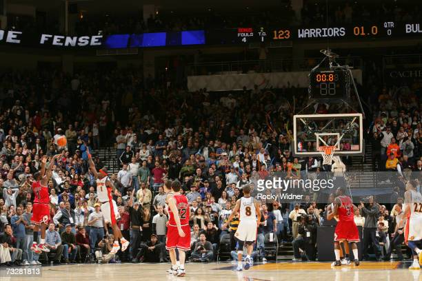 Ben Gordon of the Chicago Bulls attempts but misses a wouldbe gamewinning 3 point shot against Stephen Jackson of the Golden State Warriors on...