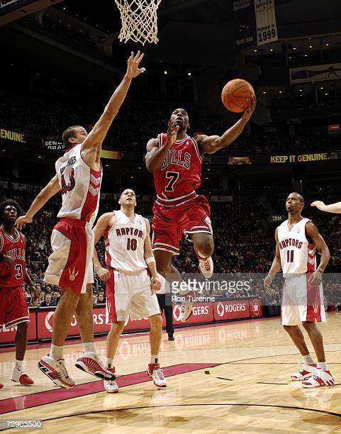 Ben Gordon of the Chicago Bulls drives past Kris Humphries of the Toronto Raptors on December 29 2006 at the Air Canada Centre in Toronto Canada NOTE...