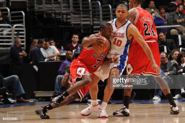 Ben Gordon of the Chicago Bulls handles the ball against Eric Gordon of the Los Angeles Clippers at Staples Center January 28 2009 in Los Angeles...