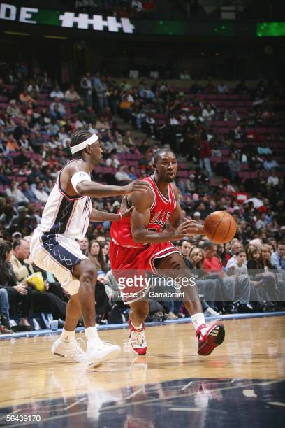 Ben Gordon of the Chicago Bulls moves the ball against Jeff McInnis of the New Jersey Nets at the Continental Airlines Arena on November 5 2005 in...
