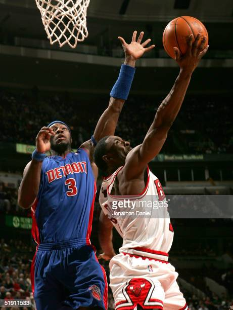 Ben Gordon of the Chicago Bulls puts up a reverse shot past Ben Wallace of the Detroit Pistons on January 3, 2005 at the United Center in Chicago,...