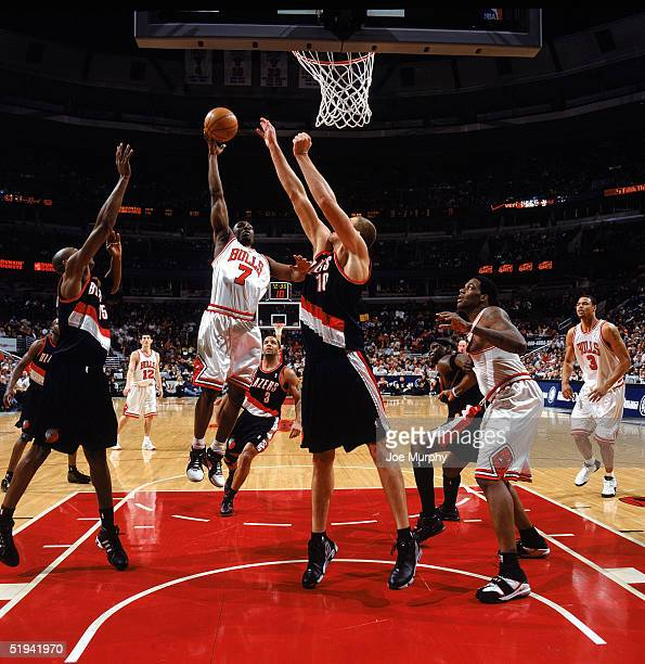 Ben Gordon of the Chicago Bulls puts up a shot against Joel Przybilla of the Portland Trail Blazers during the game on December 20, 2004 at United...