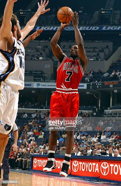 Ben Gordon of the Chicago Bulls shoots a jumper over Pau Gasol of the Memphis Grizzlies during a preseason game on October 12, 2005 at FedexForum in...