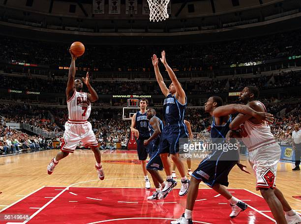 Ben Gordon of the Chicago Bulls shoots a layup over Deron Williams of the Utah Jazz during a game between the Utah Jazz and Chicago Bulls on November...