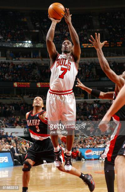 Ben Gordon of the Chicago Bulls shoots a running jumper over Damon Stoudamire of the Portland Trailblazers at the United Center on December 20, 2004...