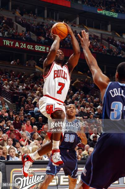 Ben Gordon of the Chicago Bulls shoots a running jumper over Jarron Collins of the Utah Jazz during a game between the Utah Jazz and Chicago Bulls on...