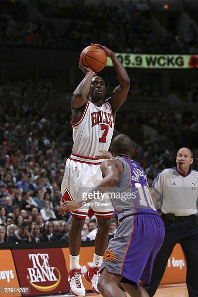 Ben Gordon of the Chicago Bulls shoots over Leandro Barbosa of the Phoenix Suns during the NBA game at the United Center January 2 2007 in Chicago...