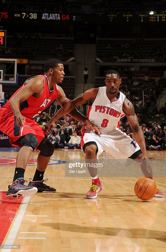 Ben Gordon #8 of the Detroit Pistons drives to the basket agaonst Joe Johnson #2 of the Atlanta Hawks during the game on March 9, 2012 at The Palace of Auburn Hills in Auburn Hills, Michigan.