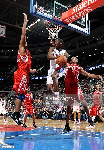 Ben Gordon of the Detroit Pistons goes to the basket against Chuck Hayes and Shane Battier of the Houston Rockets during the game on March 7 2010 at...
