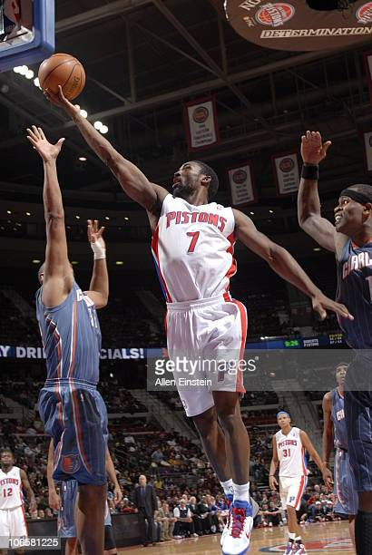 Ben Gordon of the Detroit Pistons goes up for a layup between Boris Diaw and Stephen Jackson of the Charlotte Bobcats in a game on November 5 2010 at...