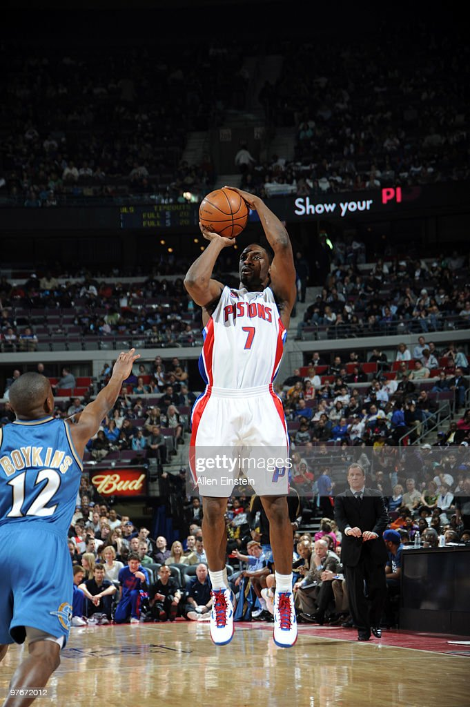 Ben Gordon #7 of the Detroit Pistons goes up for a shot attempt over Earl Boykins #12 of the Washington Wizards in a game at the Palace of Auburn Hills on March 12, 2010 in Auburn Hills, Michigan.