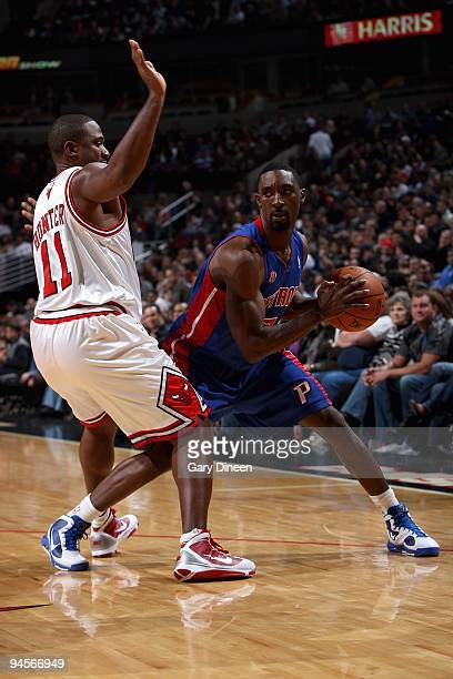 Ben Gordon of the Detroit Pistons looks for an open pass around Lindsey Hunter of the Chicago Bulls during the game at the United Center on December...