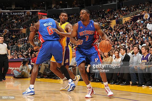 Ben Gordon of the Detroit Pistons moves around a screen set by teammate Ben Wallace on Ron Artest of the Los Angeles Lakers during the game at...