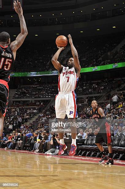 Ben Gordon of the Detroit Pistons shoots a jump shot against Amir Johnson of the Toronto Raptors during the game at the Palace of Auburn Hills on...