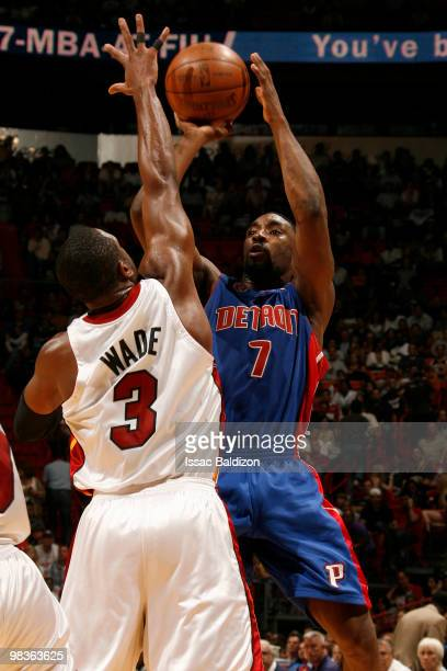 Ben Gordon of the Detroit Pistons shoots against Dwyane Wade of the Miami Heat on April 9 2010 at American Airlines Arena in Miami Florida NOTE TO...