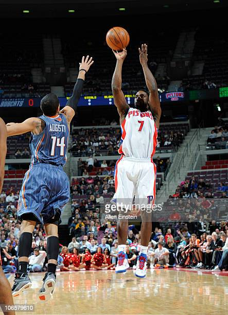 Ben Gordon of the Detroit Pistons shoots the basketball over DJ Augustin of the Charlotte Bobcats in a game on November 5 2010 at The Palace of...