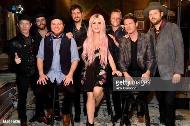 Ben Gould Gill Landry Critter Fuqua Cory Younts Kesha Matt Kinman Ketch Secor and Chance McCoy take photos backstage before CMT Crossroads featuring...