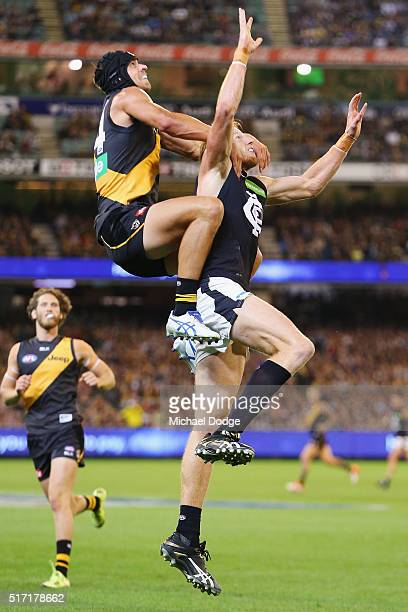 Ben Griffiths of the Tigers compete for the ball over Andrew Phillips of the Blues during the round one AFL match between the Richmond Tigers and the...