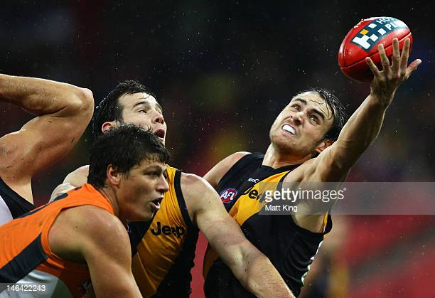 Ben Griffiths of the Tigers goes for a mark during the round 12 AFL match between the Greater Western Sydney Giants and the Richmond Tigers at Skoda...