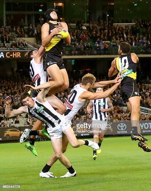 Ben Griffiths of the Tigers takes a mark during the round two AFL match between the Richmond Tigers and the Collingwood Magpies at Melbourne Cricket...