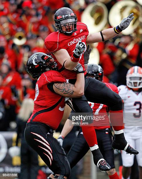 Ben Guidugli and Alex Hoffman of the Cincinnati Bearcats celebrate after Guidugli caught a touchdown pass during the game against the Illinois...